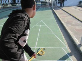 The Boy playing shuffleboard