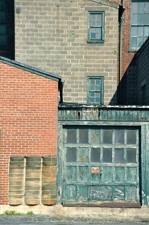 old green garage, brick,